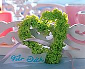 Heart of green snowball flowers
