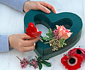Heart with anemones, waxflower and snowball blossoms