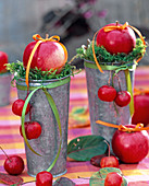 Malus (apple) on moss in high zinc vases, ribbon