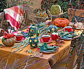 Autumn table decoration with cucurbita with stamped forms