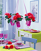 Hanging table top in pink bottles