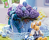Easter bouquet of Hyacinthus in checkered square vase