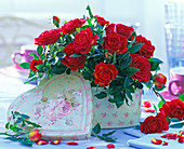Red roses (pink) in light green tin with painted roses