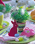 Easter table decoration with Lepidium in a striped eggcup