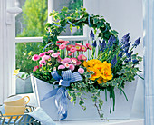 Plant wooden box with Bellis, Primula and Muscari
