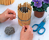 Decorate glasses with sticks of willow