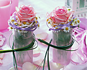 Small pink (rose) bouquets and Matricaria (Chamomilla)