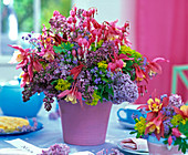 Bouquet from Dicentra, Syringa, Euphorbia