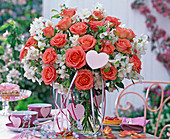 Oranges pink (rose) and malus (apple) branches bouquet
