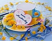 Flowers of taraxacum (dandelion) and ranunculus (buttercup)