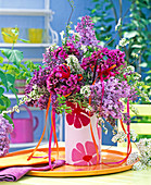 Bouquet of purple syringa, Rose Bergenia