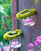 Lanterns with wreath of alchemilla (lady's mantle) on wall