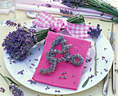 Bouquet and letter 'A' made of lavandula, pink napkin, flowers