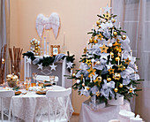 Christmas room in white and gold with Abies nordmanniana