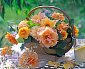 Pink 'tequila' (rose), yellow and peach, in basket