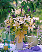 Bouquet with cream-colored lilium, alchemilla