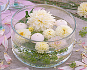 Flowers of white dahlia, anethum, white floating candles