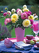 Pink and white dahlia bouquet in pink vase