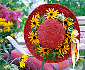 Red straw hat with Rudbeckia, and Clematis wreath