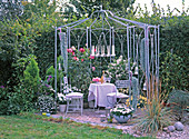 Metal pavilion with candle holder and white garnish