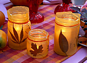Lanterns with autumn leaves and tracing paper