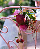 Small bouquet of Rose and malus on chair