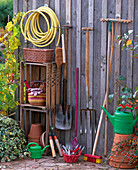 Still life with gardening equipment garden hose, broom, spade, grave fork