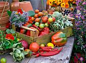 Fruit box with lycopersicon (tomato), cynara scolymus
