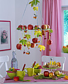 Hanging wreath with Malus (ornamental apple), Acer (maple) in autumn color