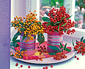 Photinia bouquets with canned yellow and red berries