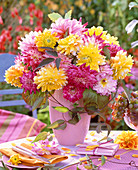 Bouquet of yellow, red and pink Dahlia, Clematis tendrils