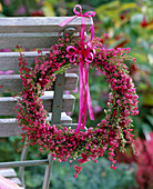 Wreath from Erica (Heath) tied with band on back by wooden chair