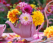 Dahlia and foeniculum bouquet in pink teapot