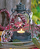 Lantern with Calluna wreaths and small bouquet on tray