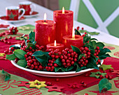 Advent wreath made of Ilex (holly) with red candles
