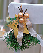 Small bouquet made of pinus, golden Christmas tree balls, star