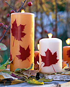 Decorate candles with wax leaves