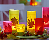 Lanterns with foliage and colorful parchment paper