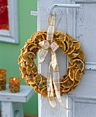Cover straw wreath with glued on orange pieces