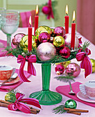 Advent wreath of red candles, Christmas tree balls, bows