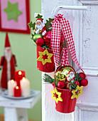 St. Nicholas decoration with metal bucket tied to door handle