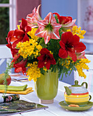 Yellow-red winter bouquet with Hippeastrum, Acacia