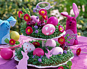 Porcelain etagere with Lepidium, decorated with felt bunnies and Easter eggs