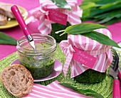 Pesto from Allium ursinum (wild garlic) in screw jars, bread