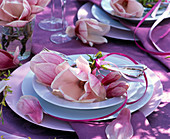 Magnolia blossom on soup plate with cutlery, dinner plate