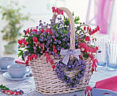 White basket with myosotis, dicentra