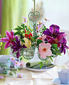 Clematis (clematis), flowers and tendrils, pink (rose)