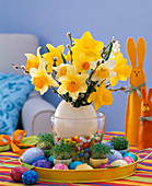 Bouquet of narcissus and salix kitten in an egg vase