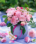 Pink (rose) bouquet in light blue vase, chickens, eggs