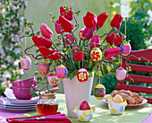 Easter bouquet of Tulipa and Corylus with Easter eggs